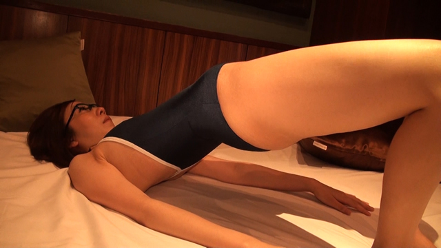 A married woman stretches in a swimsuit at a hotel!